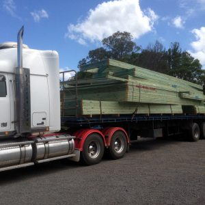 new roof trusses being transported on flatbed trailer in Sunshine Coast